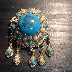 Vintage brooch teal and very light goldtone